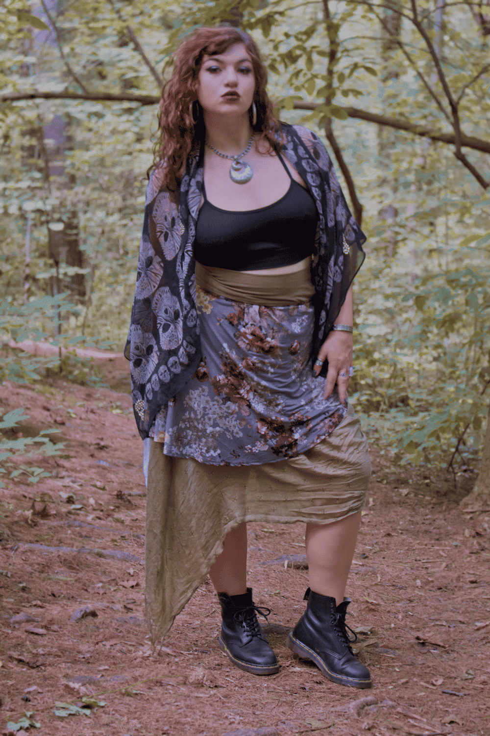 Front facing image of model in layered floral skirt